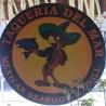 Taqueria del Mar logo and wall signage